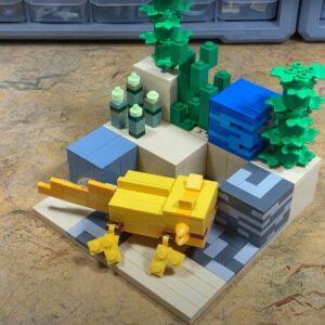 lego minecraft axolotl takes a dip in a brick built diorama