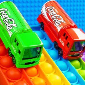 Mini Coca Cola Color Trucks Racing Pop it